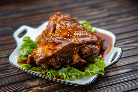 Roast pork knuckle served with boiled cabbage, bread, horseradish and mustard Stockfoto - 140416442