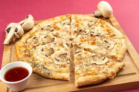 pizza close-up, isolated, against a colored background. whole pizza