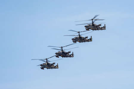 Russia, Khabarovsk - May 7, 2020: Parade in honor of victory Military air parade in honor of Victory Day. K-52 helicopters alligator fly in formation. Redakční