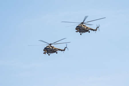 Russia, Khabarovsk - May 7, 2020: Parade in honor of victory Military air parade in honor of Victory Day. K-52 helicopters fly in formation.
