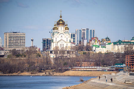 Khabarovsk city views, ponds, churches, shopping centers, residential buildings.