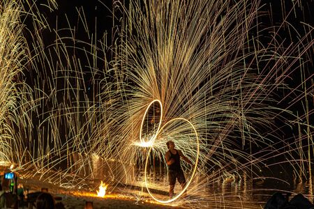 A group of fireworks in the skyundefined. Group of fireworks in the sky. fire show, fire with exposure . Thailand