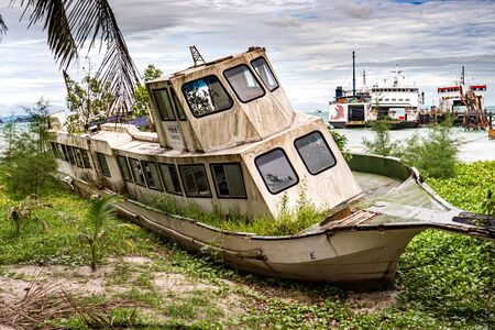 A boat parked next to a body of waterundefined Stockfoto