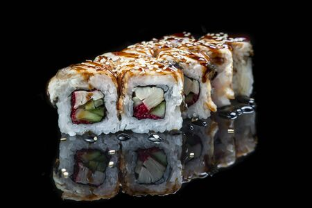 Sushi Roll On A Black Background reflection . Japanese food. Close Up.