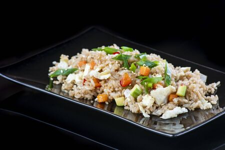 A plate of food with rice and vegetables Stockfoto