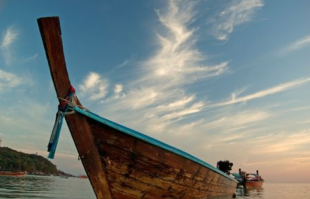Boat on beach at Lipe Island, Satun, Thailand. photo