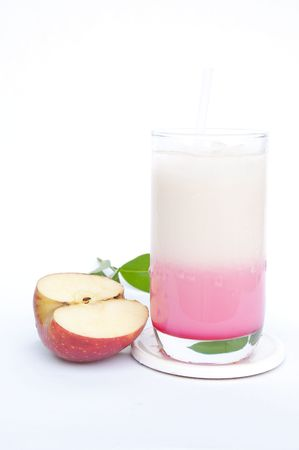 Fersh milk and red syrup with red apple.