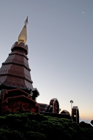 Pagoda and sunrise on mountain at Northern, Thailand.