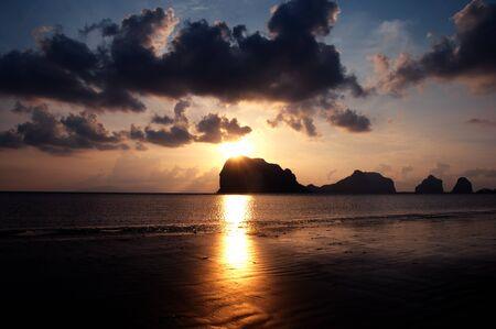 Sunset behind island at Southern, Thailand. photo