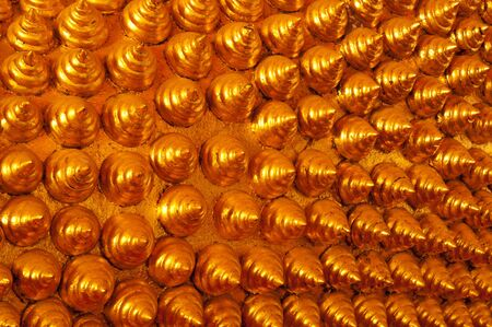 glod: Spiral pattern on the heads of Buddha statues. Stock Photo