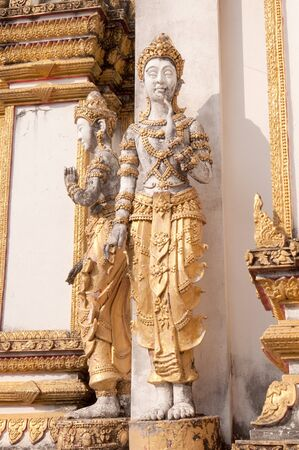 glod: Old angel statue in temple, Northern, Thailand.