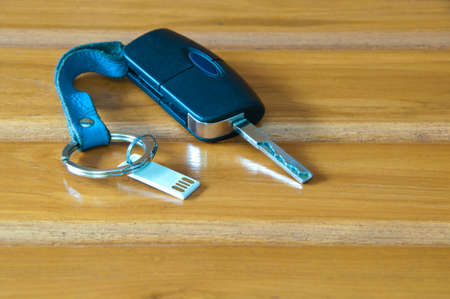 Car keys and thumb drive on the wood chair  Stock Photo