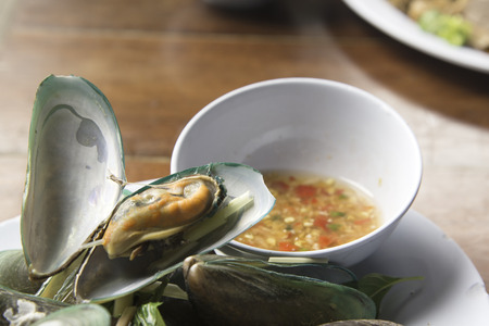 Mussel steam with Thai herb and spicy sauce.