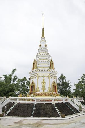 White pagoda and golden buddha. Stock Photo