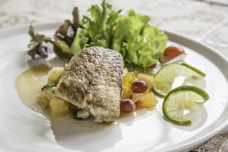 Grilled Sturgeon with salsa sauce salad. Stock Photo