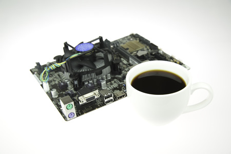 Black Coffee and Mainboard computer on isolated background.