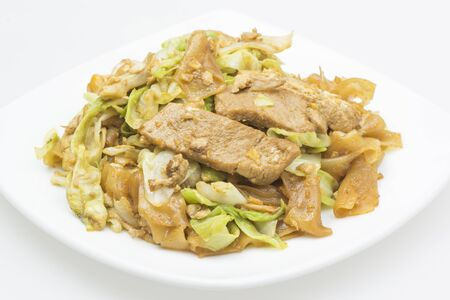 Noodles fried with pork and vegetable.