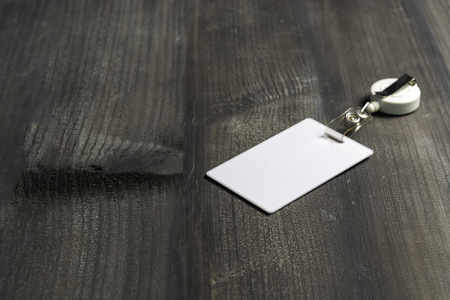 Proximity or RFID card for control security, access, protect on black wood table.