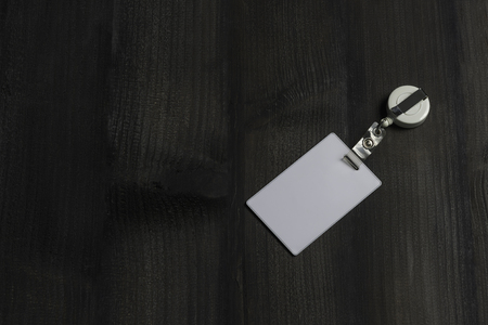 Proximity or RFID card for control security, access, protect on black wood table. Stock fotó