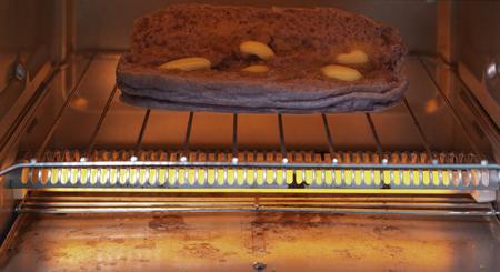 Electric micro oven grill purple sweet potato bread and butter. Фото со стока
