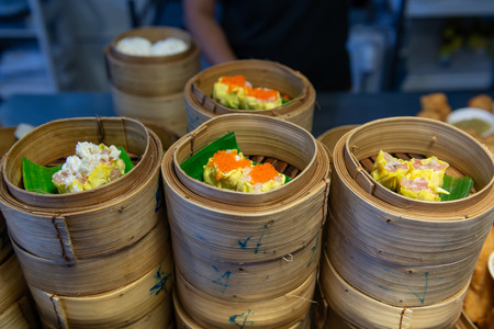 Variety of dim sum steamed in bamboo basket. Chinese breakfast style in southern of Thailand.