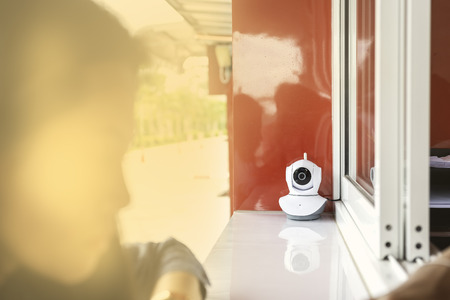 Wireless white CCTV front of shop for security.