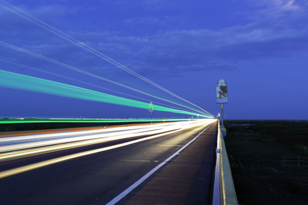 Long-exposure on twilight time made Traffic light trails on road at Phatthalung, Thailand. Фото со стока