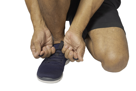 Men are wearing sports shoes for running on white background. Фото со стока