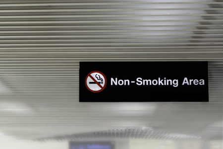 Non smoking area signs in the airport. Фото со стока