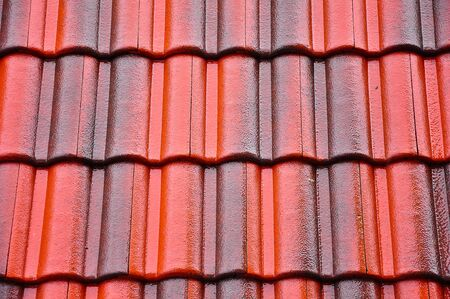 Red and black roof-tiles on the rainy day photo