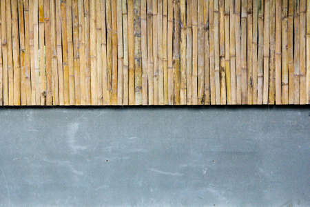 Half bamboo wall with concrete photo