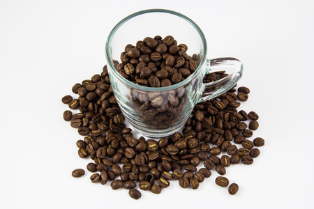 coffee beans with glass on white background photo