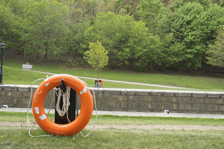 rideau canal: life ring at a park Rideau canal in Downtown Ottawa Ontario on May 21, 2016. Stock Photo