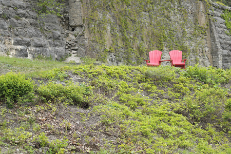 rideau canal: two chairs in park Rideau canal in Downtown Ottawa Ontario on May 21, 2016.