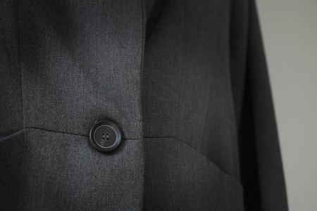tailored: black suit background