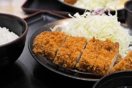 deep fried pork, Tonkatsu with shredded cabbage and rice Stock fotó