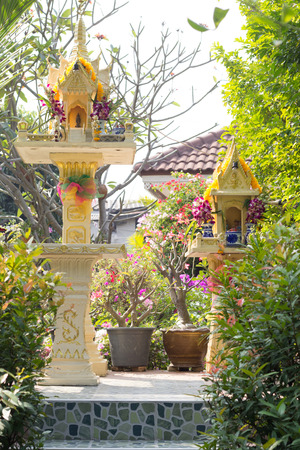 Shrine of Thai household god and guardian spirit grandfather and grandmother. photo