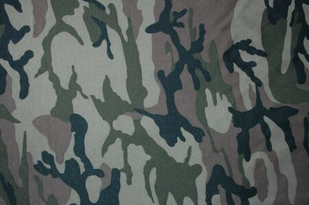 Camouflage fabric in the green range. Stock Photo