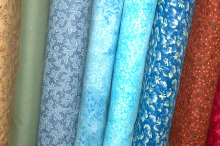 Bolts of quilting fabric in the blue range.