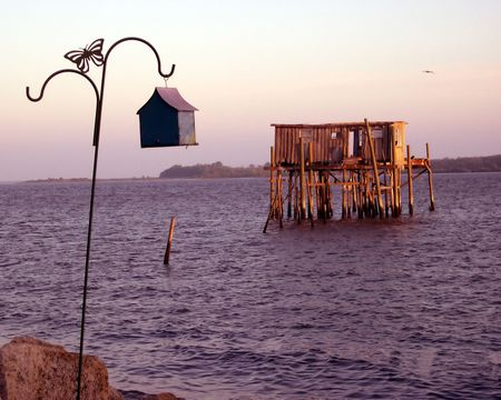 The old fish house and a new bird house at sunset at Cedar Key, Florida on the Gulf of Mexico. Stock Photo - 404547