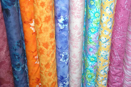 Bolts of floral quilting fabric. Stock Photo