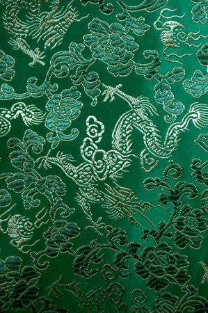 Green oriental silk with a dragon pattern.