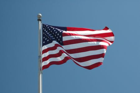 An American flag flaps in the wind.