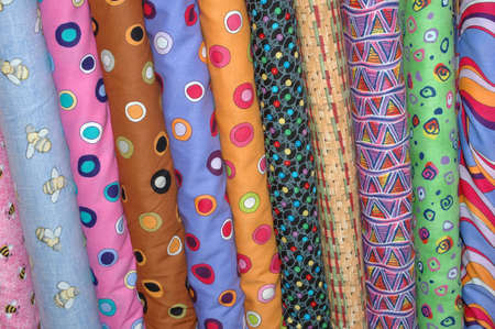 Colorful bolts of quilting fabric.