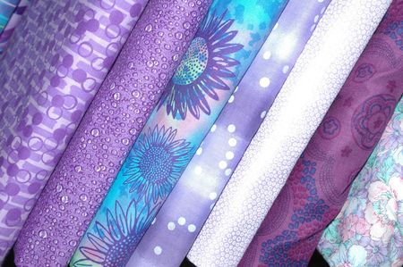 Quilt fabrics in the purple and lavender range.