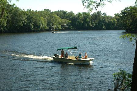A family enjoys boating on the Suwannee River. Stok Fotoğraf