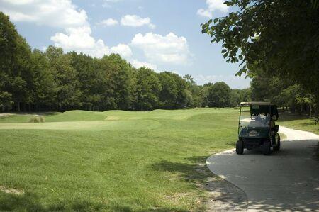 Golf Cart on the links. Фото со стока