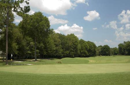 A hole on the golf course.
