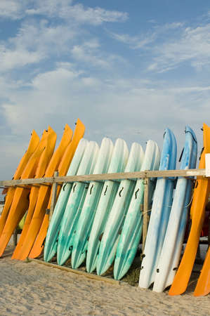 Kayaks are lined up at a rental facility.