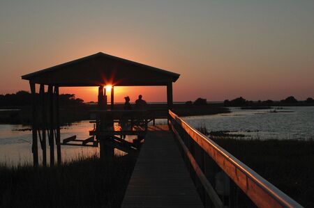 Sunset at the boat house on Cedar Key, Florida. photo